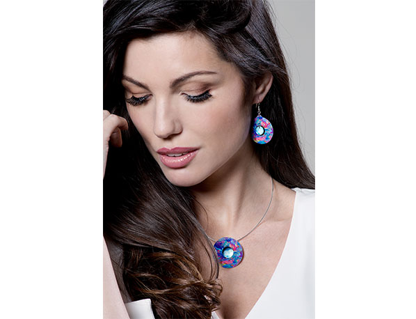 Model wearing Confetti Blue pod pendant