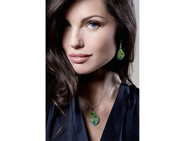 Pixalum Model wearing Honesty Green pendant